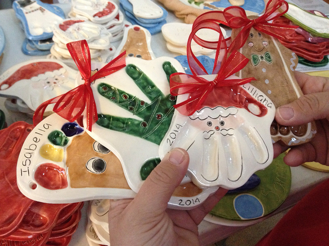 Holiday ceramic handprints and footprints are seen at Connie Hallett's home in Centennial Hills, Wednesday, Dec. 3, 2014. Hallett launched Tiny Impressions as an effort to stay at home with her ch ...