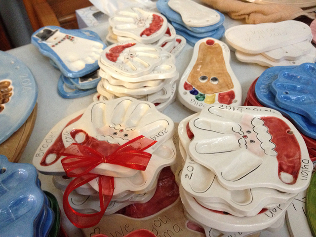 Holiday ceramic handprints and footprints are seen at Connie Hallett's home in Centennial Hills, Wednesday, Dec. 3, 2014. Hallett launched Tiny Impressions in 2003 as an effort to stay at home wit ...