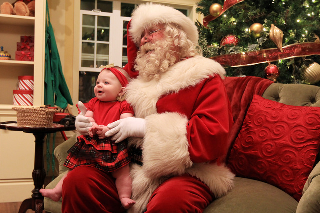 Santa sits for a photo with Brooklynn Banks in his house at Town Square Friday, Nov. 28, 2014. (Sam Morris/Las Vegas Review-Journal)