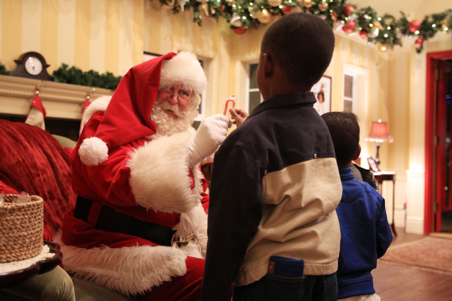 Santa offers Quaentan Collins a candy cane in his house at Town Square Friday, Nov. 28, 2014. (Sam Morris/Las Vegas Review-Journal)