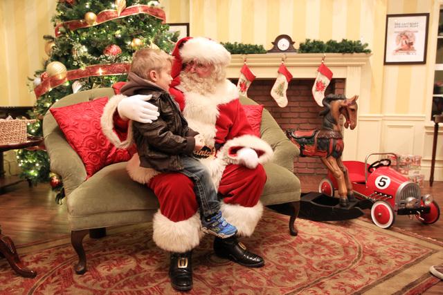 Santa asks 4-year-old Logan Biltz what he wants for Christmas at Town Square Friday, Nov. 28, 2014. (Sam Morris/Las Vegas Review-Journal)