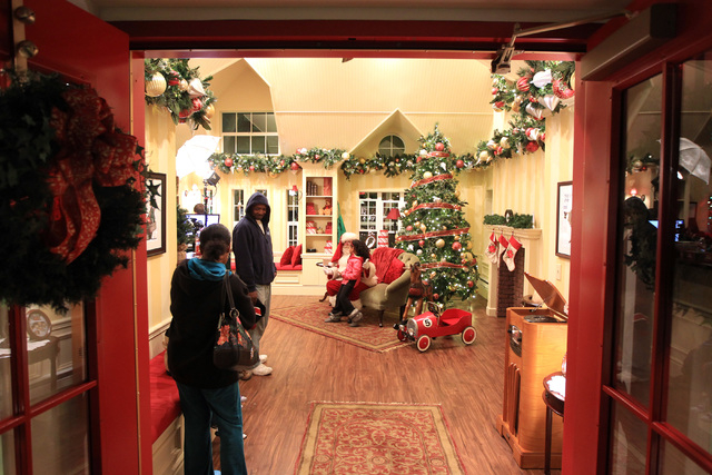 Santa asks Vianney Jordan what she wants for Christmas at Town Square Friday, Nov. 28, 2014. (Sam Morris/Las Vegas Review-Journal)