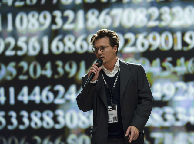 """Johnny Depp stars as Will Caster in the sci-fi thriller """"Transcendence,"""" a trope of a scientist in a computer that has been better done many times before. (Peter Mountain/Warner Bros. Pictures)"""