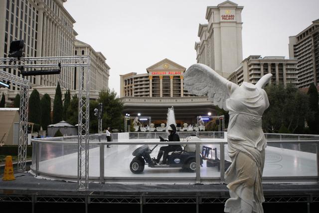 Employees work on the ice rink near Caesars Palace casino-hotel in Las Vegas Tuesday, Dec. 2, 2014. (Erik Verduzco/Las Vegas Review-Journal)