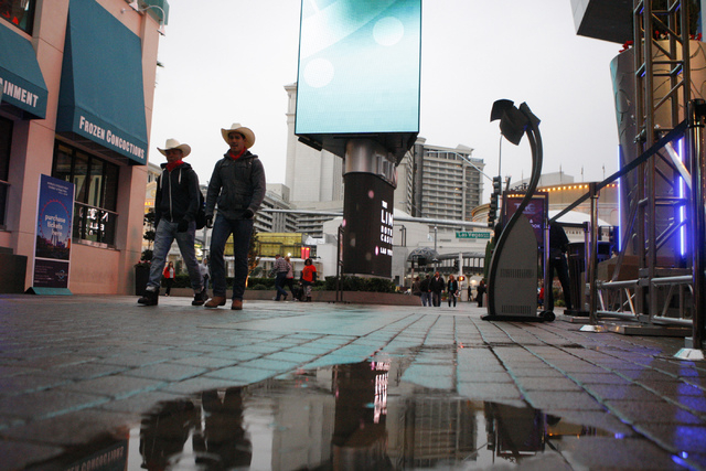 Devin Williams, left, and Michael Quagge, walk at The Linq  in Las Vegas Tuesday, Dec. 2, 2014. (Erik Verduzco/Las Vegas Review-Journal)