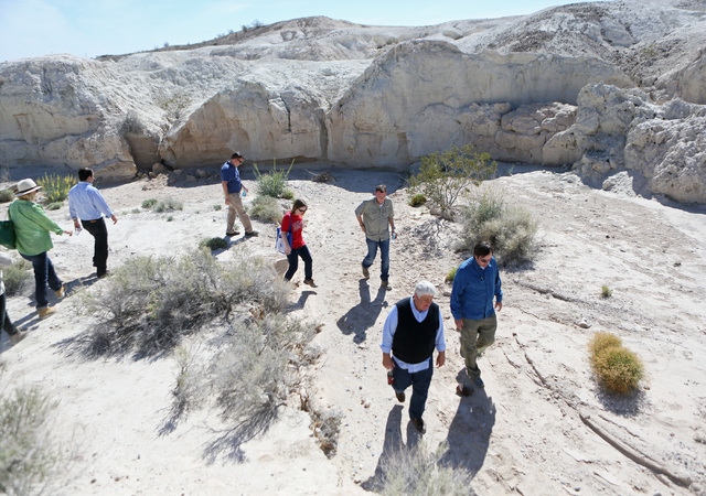 Rep. Rob Bishop, R-Utah, front center, walks with Ryann Juden (cq), right, executive government affairs liaison for the City of North Las Vegas, during a tour of a portion of the proposed Tule Spr ...