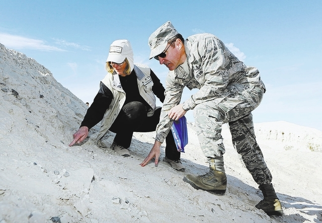 Jill DeStefano, left, president of Protectors of Tule Springs, shows U.S. Air Force Col. Rob Ramsden an area of concentrated fossils during a private tour of a small portion of the Tule Springs Fo ...