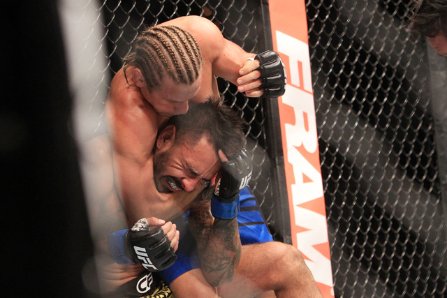 Urijah Faber submits Francisco Rivera with a choke during the second round of their fight at UFC 181 Saturday, Dec. 6, 2014 at the Mandalay Bay Events Center. (Sam Morris/Las Vegas Review-Journal)