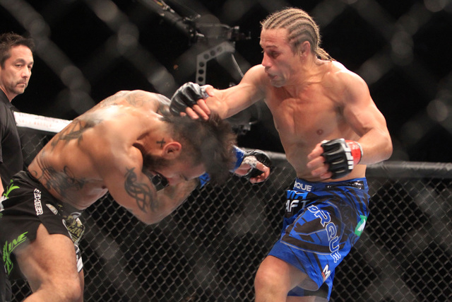 Urijah Faber hits Francisco Rivera with a right during their fight at UFC 181 Saturday, Dec. 6, 2014 at the Mandalay Bay Events Center. Faber won by submission. (Sam Morris/Las Vegas Review-Journal)
