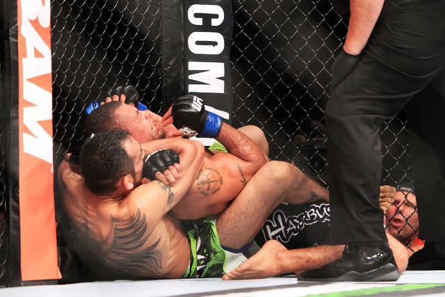 Tony Ferguson submits Abel Trujillo with a rear naked choke during their fight at UFC 181 Saturday, Dec. 6, 2014 at the Mandalay Bay Events Center. (Sam Morris/Las Vegas Review-Journal)
