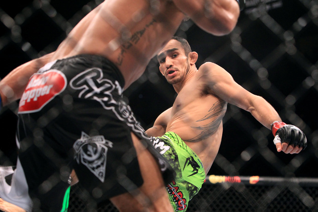 Tony Ferguson throws a kick at Abel Trujillo during their fight at UFC 181 Saturday, Dec. 6, 2014 at the Mandalay Bay Events Center. Ferguson won by submission with a rear naked choke. (Sam Morris ...