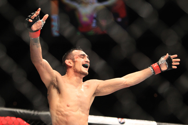 Tony Ferguson celebrates his submission of Abel Trujillo during their fight at UFC 181 Saturday, Dec. 6, 2014 at the Mandalay Bay Events Center. Ferguson won by submission with a rear naked choke. ...