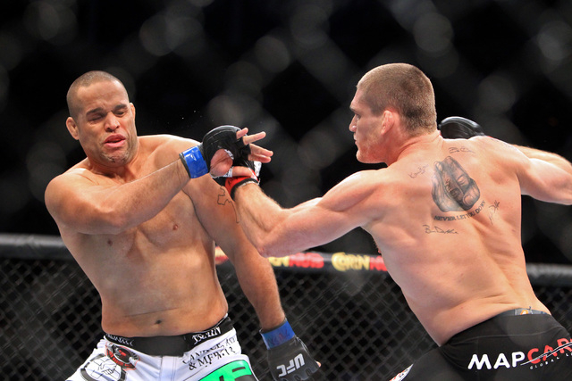 Todd Duffee chases down Anthony Hamilton during their fight at UFC 181 Saturday, Dec. 6, 2014 at the Mandalay Bay Events Center. Duffee knocked out Hamilton 31 seconds into the first round. (Sam M ...