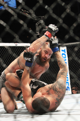 Travis Browne pounds on Brendan Schaub during their fight at UFC 181 Saturday, Dec. 6, 2014 at the Mandalay Bay Events Center. Browne won by TKO in the first. (Sam Morris/Las Vegas Review-Journal)
