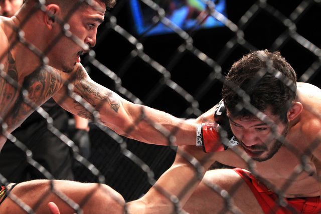 Anthony Pettis hits Gilbert Melendez during their fight at UFC 181 Saturday, Dec. 6, 2014 at the Mandalay Bay Events Center. (Sam Morris/Las Vegas Review-Journal)