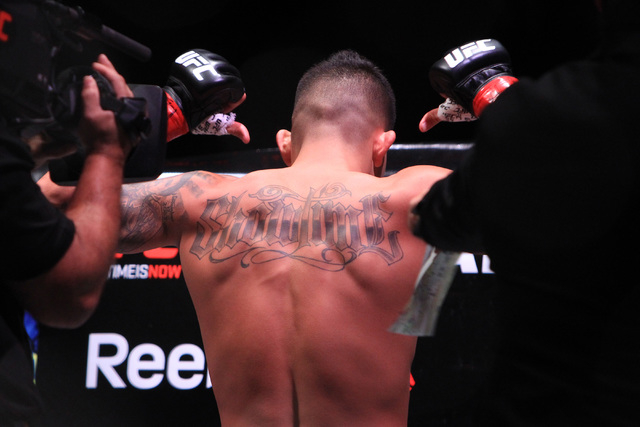 Anthony Pettis points to his tattoo before his fight against Gilbert Melendez at UFC 181 Saturday, Dec. 6, 2014 at the Mandalay Bay Events Center.  (Sam Morris/Las Vegas Review-Journal)