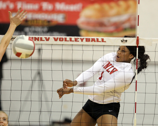 UNLV's Ceannia Kincade (1) spikes the ball against Fresno State in the third set of a volleyball game at Cox Pavilion in Las Vegas Thursday, Sept. 25, 2014. UNLV went on to beat Fresno State 3-0.  ...