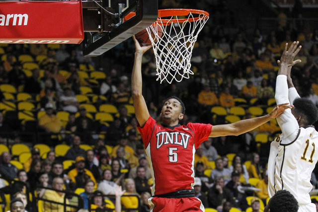 UNLV Runnin' Rebels forward Christian Wood (5) shoots against Wyoming Cowboys forward Derek Cooke Jr. (11)during the first half at Arena-Auditorium. (Troy Babbitt-USA TODAY Sports)