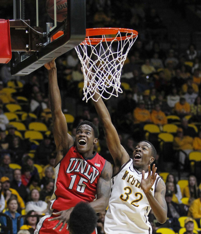 UNLV Runnin' Rebels forward Dwayne Morgan (15) shoots against Wyoming Cowboys forward Alan Herndon (32)during the first half at Arena-Auditorium. (Troy Babbitt-USA TODAY Sports)