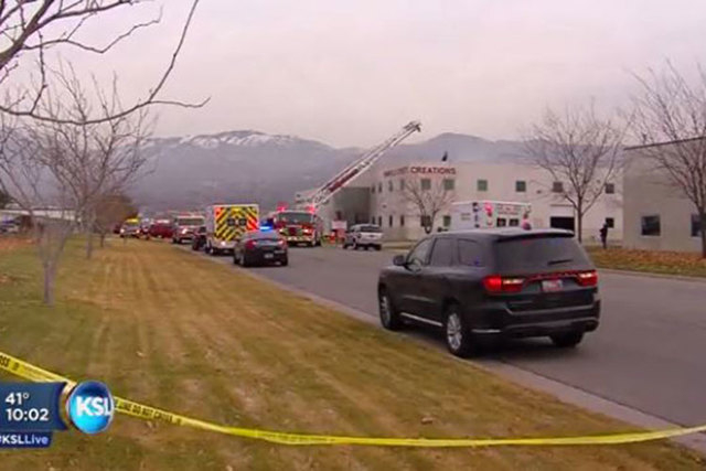 Two men died when their helicopter crashed through the roof of an unoccupied building north of Salt Lake City on Tuesday, Dec. 2, 2014, a fire official said. (Screengrab/KSL)