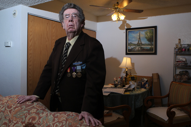 Korean War Army veteran Charles Mahoney poses for a portrait at his home in Las Vegas Thursday, Dec. 11, 2014.  Mahoney is currently waiting for compensation from the U.S. Department of Veterans A ...