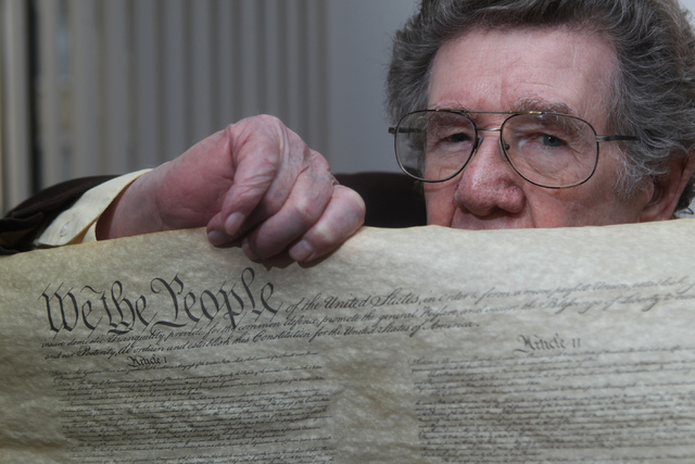 Korean War Army veteran Charles Mahoney poses for a portrait with a copy of the U.S. Constitution at his home in Las Vegas Thursday, Dec. 11, 2014.  Mahoney claims the U.S. Constitution failed him ...