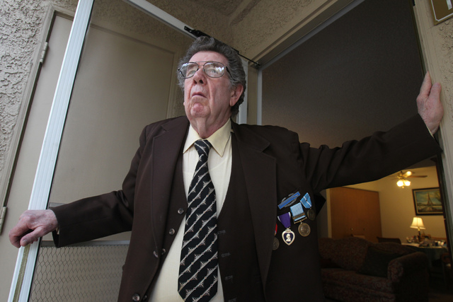 Korean War Army veteran Charles Mahoney stands in front of his home in Las Vegas Thursday, Dec. 11, 2014.  Mahoney is currently waiting for compensation from the U.S. Department of Veterans Affair ...