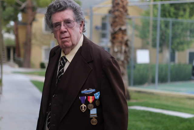 Korean War Army veteran Charles Mahoney poses for a photo in front of his home in Las Vegas Thursday, Dec. 11, 2014.  Mahoney is currently waiting for compensation from the U.S. Department of Vete ...