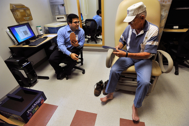 Prosthetic fitter Jesse Cintora Jr., left, works with retired Army Colonel Larry Masters on fitting a new pair of orthotic insoles at the VA Southern Nevada Healthcare System in North Las Vegas on ...