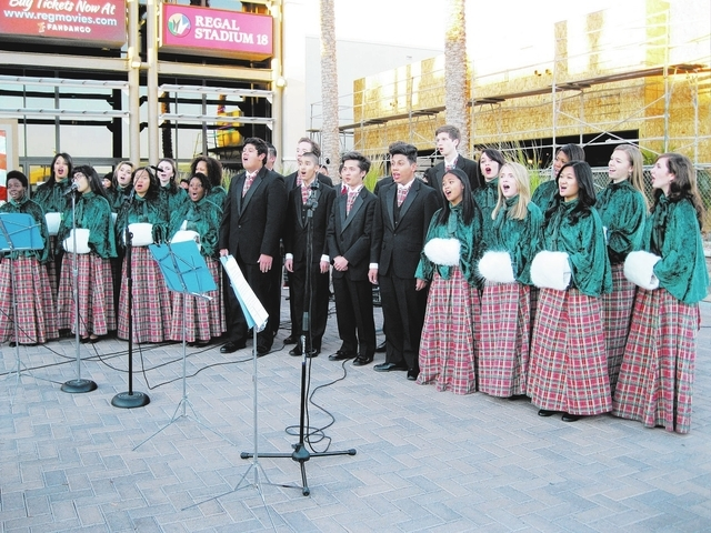 Students from Las Vegas Academy sing carols Nov. 30, 2013, at Village Square, 9400 W. Sahara Ave., as the shopping center heralded the holiday season with a Christmas tree-lighting ceremony. (Spec ...