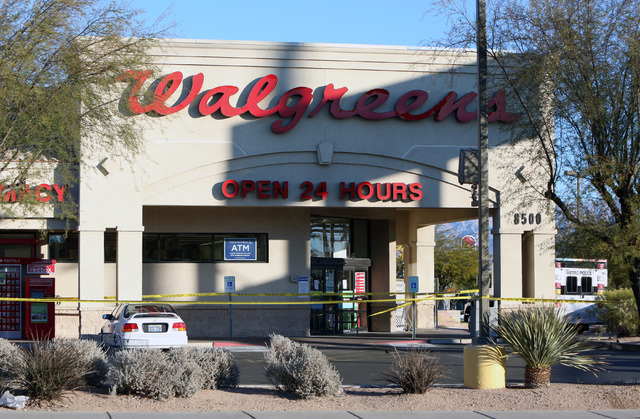Crime scene tape is used to seal off a  Walgreens where the robber shot and killed an employee in a back room at 8500 W. Cheyenne, near Durango on Friday, Dec. 26, 2014,  in Las Vegas police said. ...