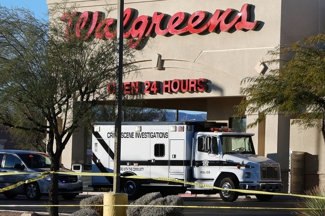Crime Scene Investigations truck is parked outside a Walgreens where the robber shot and killed an employee in a back room at 8500 W. Cheyenne, near Durango on Friday, Dec. 26, 2014,  in Las Vegas ...