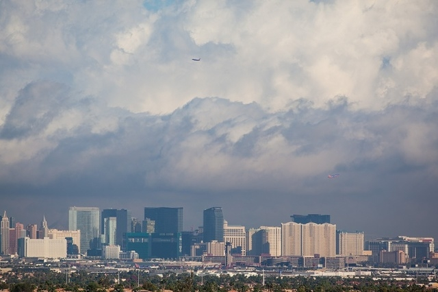 Clouds hover above the Las Vegas Valley as seen from Green Valley Ranch on Tuesday, Sept. 9, 2014. A weather system that is bringing heavy rainfall to Northern California and southern parts of Ore ...