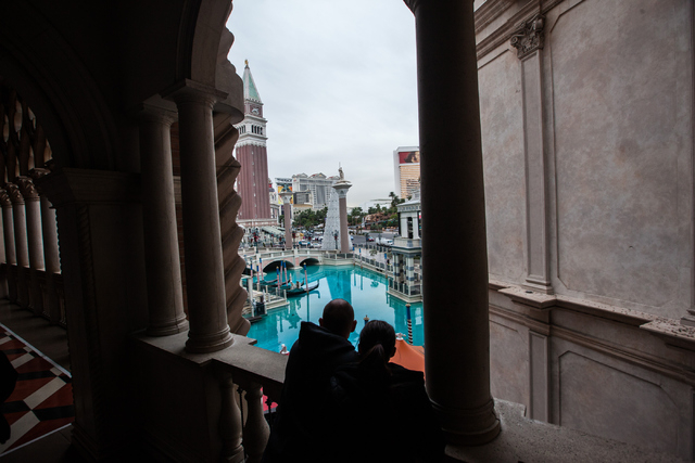 People look out at the Strip from the Venetian hotel-casino as light rain comes down in Las Vegas on Tuesday, Dec. 2, 2014. (Chase Stevens/Las Vegas Review-Journal)