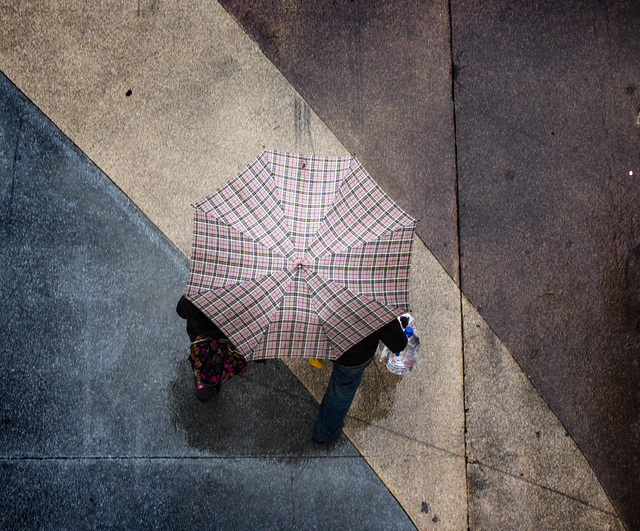 A couple share an umbrella while walking on Fremont Street near Las Vegas Boulevard on Tuesday, Dec. 02, 2014.  The forecast calls for rain in the Las Vegas valley through Thursday afternoon.(Jeff ...