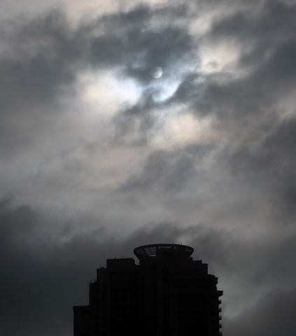 The sun peeks through the morning fog and clouds Friday, Dec. 5, 2014, in Las Vegas. Skies will clear slightly Friday afternoon, but another upper-level system will roll in Friday evening and into ...