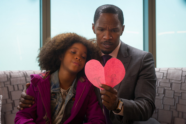 Annie (QUVENZHANE WALLIS) has made a card for Will Stacks (JAMIE FOXX) in Columbia Pictures' ANNIE.