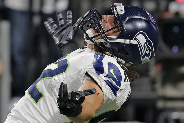 Seattle Seahawks tight end Luke Willson celebreats his touchdown during the first half of an NFL football game against the Arizona Cardinals, Sunday, Dec. 21, 2014, in Glendale, Ariz. (AP Photo/Ri ...