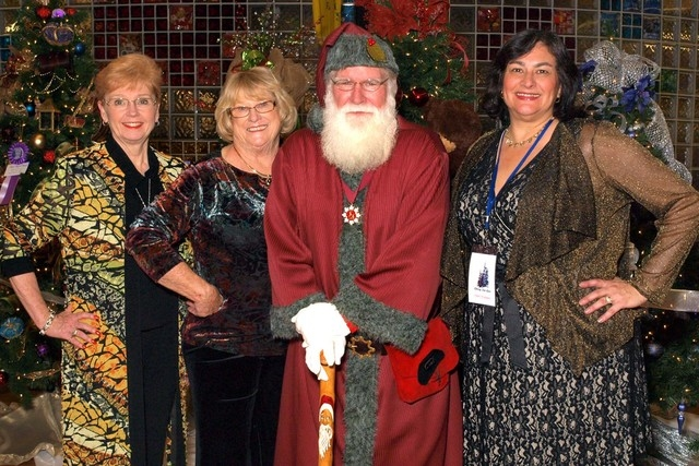 Diane Collins, from left, Andrea Frazier, Santa and Julia Buckley (Marian Umhoefer/Las Vegas Review-Journal)