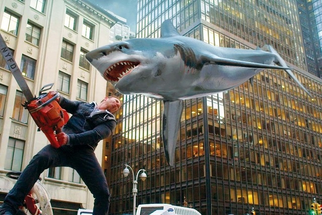 """In this image released by Syfy, Ian Ziering, as Fin Shepard, battles a shark on a New York City street in a scene from """"Sharknado 2: The Second One,"""" premiering Wednesday at 9 p.m. EDT.  ..."""