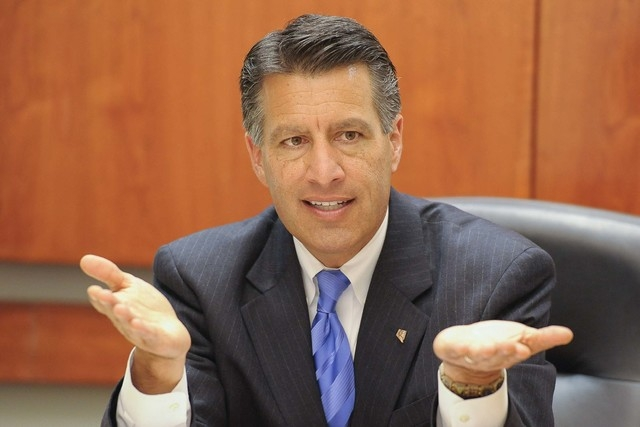 Gov. Brian Sandoval is shown here as he speaks to the Las Vegas Review-Journal editorial board on Thursday, Oct. 9, 2014. Sandoval said Friday he is not getting involved in the ongoing Assembly le ...