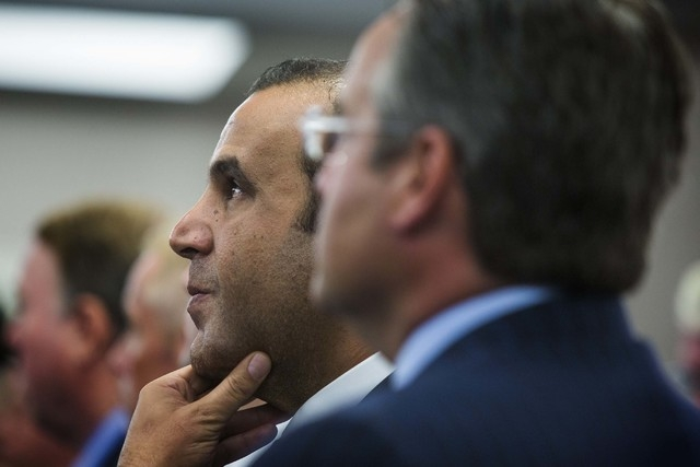 Sam Nazarian, CEO of SBE Entertainment, listens during the Nevada Gaming Commission gaming license hearing for SLS Las Vegas at the Sawyer Building, Aug. 21, 2014. (Jeff Scheid/Las Vegas Review-Jo ...