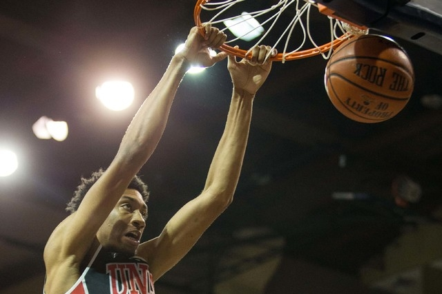 UNLV Rebels forward Christian Wood (5) dunks during the first half against the South Dakota Coyotes at Sanford Pentagon in Sioux Falls, S.D., on Saturday, Dec. 13, 2014. (Brace Hemmelgarn-USA TODA ...