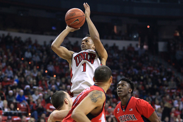 UNLV guard Rashad Vaughn shoots over the top of Arizona defenders during their game Tuesday, Dec. 23, 2014 at the Thomas & Mack Center. (Sam Morris/Las Vegas Review-Journal)