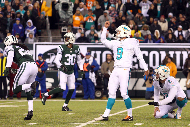 Miami Dolphins kicker Caleb Sturgis (9) kicks a field goal against the New York Jets during the fourth quarter of a game at MetLife Stadium. The Dolphins defeated the Jets 16-13.(Brad Penner-USA T ...
