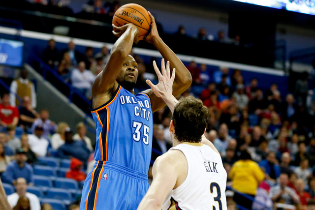 Oklahoma City Thunder forward Kevin Durant (35) shoots over New Orleans Pelicans center Omer Asik (3) during the second half of a game at the Smoothie King Center. The Pelicans defeated the Thunde ...