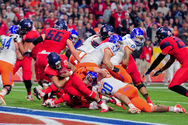 Arizona Wildcats quarterback Anu Solomon (12) runs for a 1 yard touchdown during the first half against the Boise State Broncos in the 2014 Fiesta Bowl at Phoenix Stadium. (Matt Kartozian-USA TODA ...