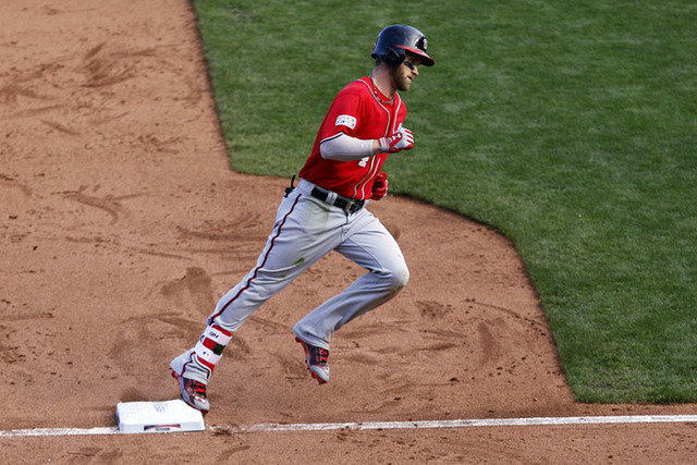 Washington Nationals left fielder Bryce Harper (34) rounds third base after hitting a home run during the ninth inning against the San Francisco Giants in game three of the 2014 NLDS baseball play ...