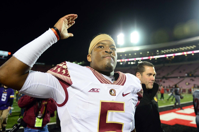 Florida State Seminoles quarterback Jameis Winston (5) walks off the field after defeating the Louisville Cardinals 42-31 at Papa John's Cardinal Stadium. (Andrew Weber-USA TODAY Sports)