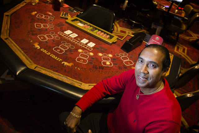 Former UNLV men's basketball star Bobby Florence sits at a Rabbit's Play baccarat table in the Gold Coast hotel-casino on Monday, Dec. 15, 2014. Florence has developed a new baccarat game which pr ...